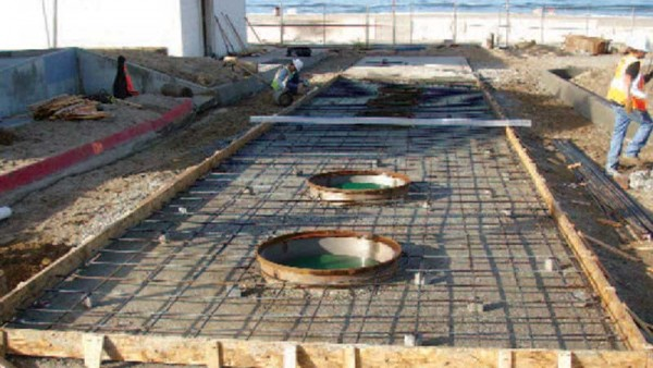 Malibu beach installation of below-grade wastewater tanks